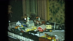 1951: child watching a miniature train that is working on a white table around Stock Footage