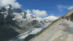 Hiker walking along the Gramsgrubenweg path at Grossglockner Mountain area. Stock Footage