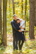 Love, parenthood, family, season and people concept - smiling couple with baby Stock Photos