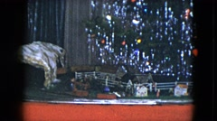 1951: miniature train moving on a railroad under a rotating christmas tree Stock Footage