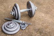 Close up dumbbells on cement floor Stock Photos