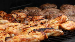 Bbq Sauce On Chicken And beef ribs On A grill outdoors ribfest T-Bone Steak Stock Footage