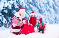 Kids and Santa with Christmas presents Stock Photos