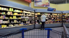 Woman shopping dairy milk cheese department POV Stock Footage