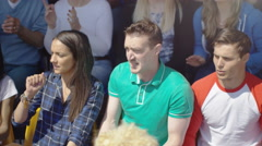 4K Excited supporter in sports crowd, celebrating & cheering on his team Stock Footage