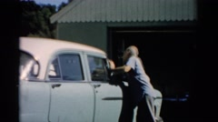 1957: man cleaning his car CATSKILL, NEW YORK Stock Footage