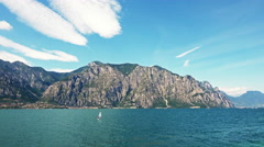 The Garda Lake in Italy. Lake Between Mountains with Crystal Water. Stock Footage