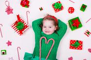 Little girl opening Christmas presents Stock Photos