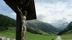 Wooden altar with jesus figure in european alps Stock Footage