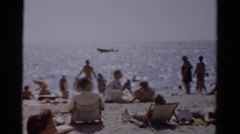 1957: many people sunbathing on beach on sunny summer day CATSKILL, NEW YORK Stock Footage