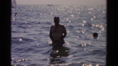 1957: a man is enjoying a day at the beach. CATSKILL, NEW YORK Stock Footage