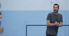 4k, Basketball team practicing with coach before a match at an indoor court. Stock Footage