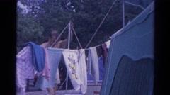 1962: man outdoor clothes talking suit walking garden loving CATSKILL, NEW YORK Stock Footage