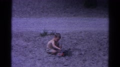 1962: topless kid play desert beach sand build fun CATSKILL, NEW YORK Stock Footage