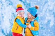 Kids playing outdoors in winter Stock Photos