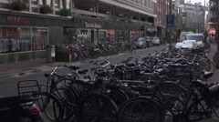 Parking place for bikes on the street of Amsterdam. 4K Stock Footage