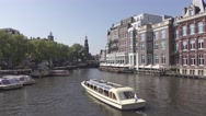 Tour boats on water channel in Amsterdam. 4K Stock Footage