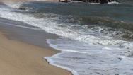 Beach and waves, bright sun. Stock Footage