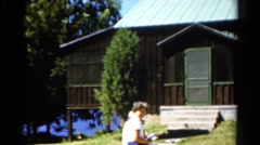1962: people gathering outdoor a beautiful wooden building. CATSKILL, NEW YORK Stock Footage