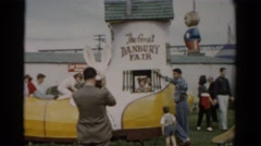 1957: kids frolic and play while their parents watch at a fair with activities Stock Footage