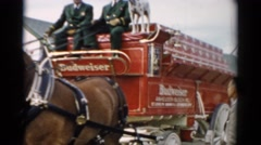 1957: budweiser advertised on a carriage pulled by horses during a parade Stock Footage