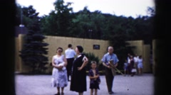 1957: various people gathered outdoor a wall or a compound CATSKILL, NEW YORK Stock Footage