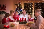 Family enjoying Christmas dinner at home Stock Photos