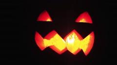 Candle burns inside jack o lantern on a halloween lot of smoke close up shot Stock Footage
