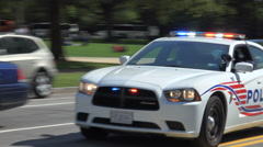 DC police cruiser races past, responding, siren Stock Footage