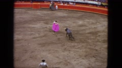 1962: a bullfight arena is filled with matadors and lancers on horseback Stock Footage