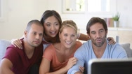 Friends in front of TV watching game Stock Footage