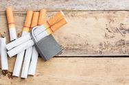 Tobacco cigarettes with lock on a wooden table background Stock Photos
