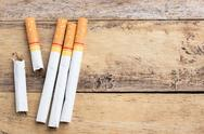 Tobacco cigarettes on a wooden table background Stock Photos