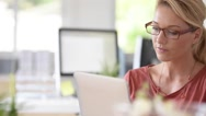 Attractive home-office woman working on digital tablet Stock Footage