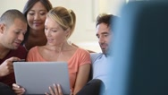 Group of friends using laptop and buying online, e-shopping Stock Footage