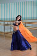 Beautiful woman dancing in arabic costume, oriental or belly dance Stock Photos