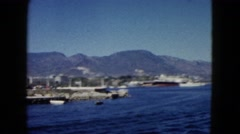 1962: peaceful day at the pier with clear skies and boats MEXICO Stock Footage