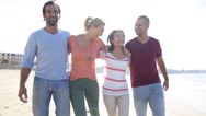 Group of friends walking on the beach Stock Footage