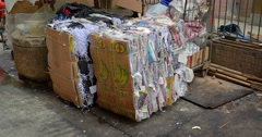 Compacted and Baled Paper Trash for Recycling in Hong Kong Stock Footage
