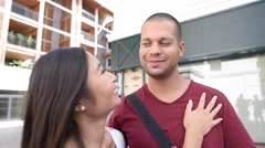Mixed-race couple embracing each other in town Stock Footage