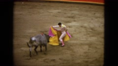 1962: a man working as a torero in a bullring assisted by another torero MEXICO Stock Footage