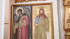 Baptism. The icons of Orthodox saints. Zoom shot Stock Footage