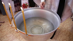 Baptism. The priest baptizes the water in the font Stock Footage