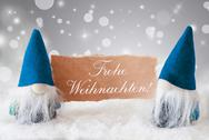 Blue Gnomes With Card, Frohe Weihnachten Means Merry Christmas Stock Photos
