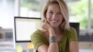 Portrait of smiling businesswoman in office Stock Footage