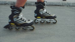 Mans legs roller skating inline close up on the asphalt Stock Footage