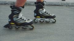 Mans legs roller skating inline close up on the asphalt Stock Footage