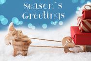Reindeer, Sled, Light Blue Background, Text Seasons Greetings Stock Photos