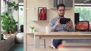 Entrepreneur has phone conversation via internet Stock Footage