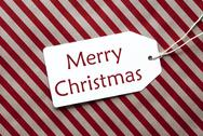 Label On Red Wrapping Paper, Text Merry Christmas Stock Photos